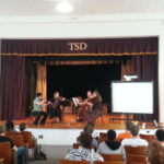 Members of KSO playing on Tennessee School for the Deaf page