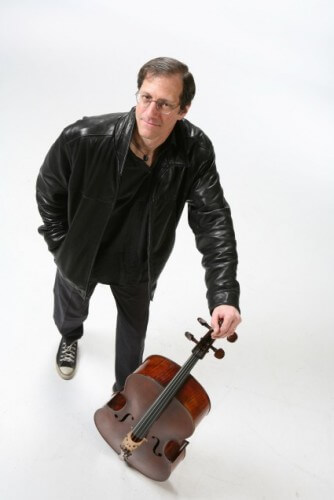 Andy Bryenton standing next to cello
