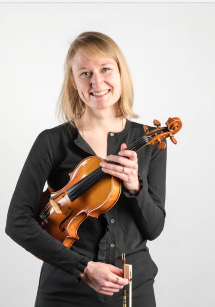 Audrey Pride holding violin