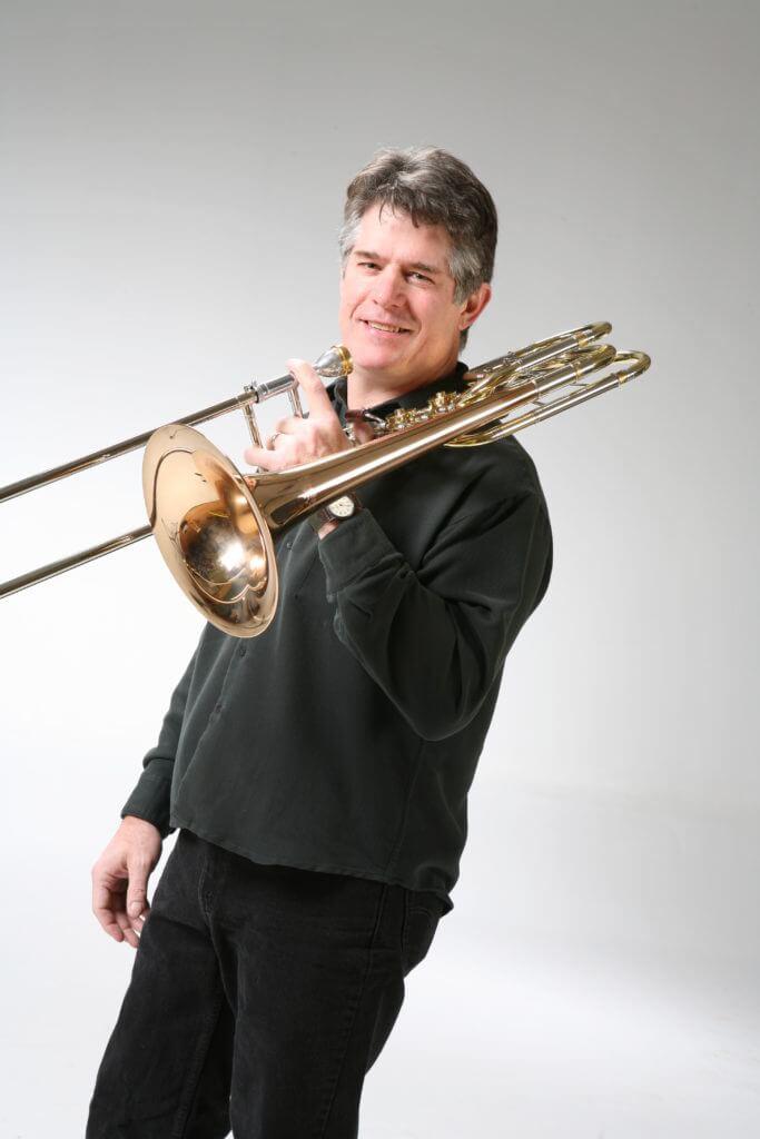 Brad McDougall holding his trombone