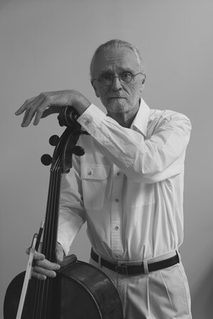 Headshot of Scot Williams standing next to his cello