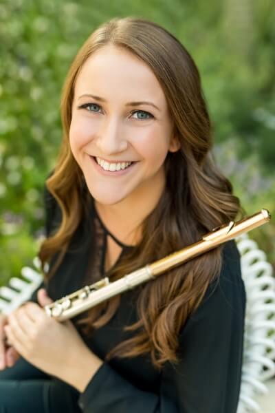 Hannah holding her flute