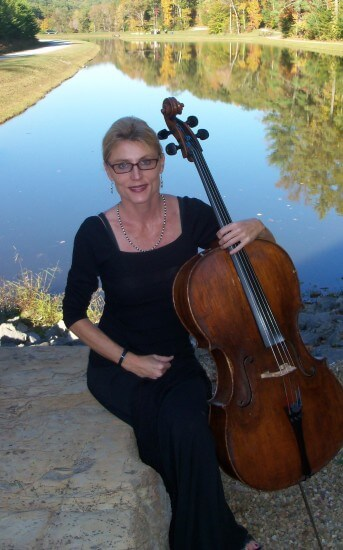 Stacy Nickell holding cello