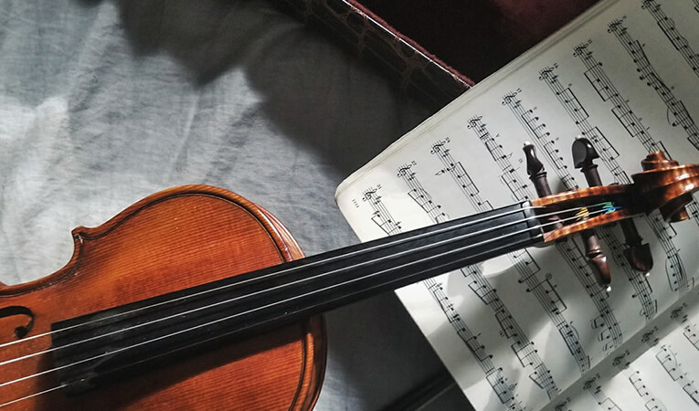 Violin next to sheet music